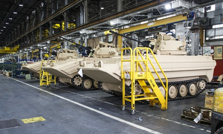 A line of M113A3/BMP-2 Opposing Forces Surrogate Vehicles await the final production at Anniston Army Depot's Combat Vehicle Repair Facility in Alabama, Oct. 2, 2017.