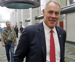 Interior Secretary Ryan Zinke walks through a hunting expo in Utah.