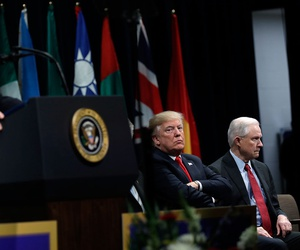 Christopher Wray speaks at  the FBI National Academy graduation ceremony in Quantico, Va. in December as Donald Trump and Jeff Sessions listen.