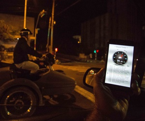 In this Nov. 20, 2016 photo, a sound meter on a mobile phone shows 89 decibels as a motorcycle with a side car drones by on 23rd street in Havana, Cuba.