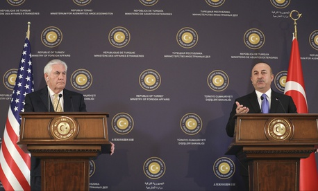 Turkey's Foreign Minister Mevlut Cavusoglu, right, talks as U.S. Secretary of State Rex Tillerson, left, listens during a joint news conference following their meeting in Ankara, Turkey, Friday, Feb. 16, 2018.