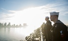 Sailors and Marines aboard the amphibious assault ship USS America (LHA 6) as it returns to its homeport of Naval Base San Diego, Feb. 2, 2018.