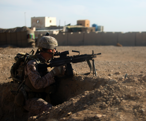 A U.S. Marine with Task Force Southwest provides security during a patrol near Bost Airfield, Afghanistan.