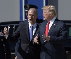 President Donald Trump talks with Boeing CEO Dennis Muilenburg upon his arrival on Air Force One at Charleston International Airport in North Charleston, S.C.,  in February 2017.