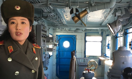 In this Wednesday, Jan. 24, 2018, photo, a North Korean military guide leads a tour of the USS Pueblo in Pyongyang, North Korea. The Pueblo, an American spy ship, was attacked and captured by North Korea 50 years ago.