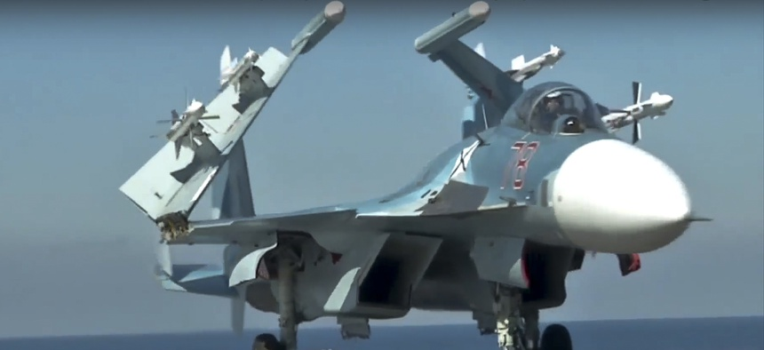 n this photo made from the footage taken from Russian Defense Ministry official web site on Tuesday, Nov. 15, 2016, a Russian Su-33 fighter jet stands on the flight deck of the Admiral Kuznetsov aircraft carrier in the eastern Mediterranean Sea.