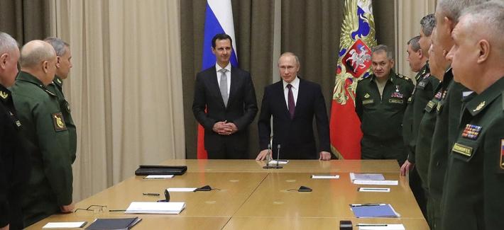 Russian President Vladimir Putin, Syrian President Bashar Assad, and Russian Defense Minister Sergei Shoigu meet with Russian military chiefs in the Bocharov Ruchei residence in the Black Sea resort of Sochi, Russia, Nov. 20, 2017.