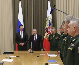 Russian President Vladimir Putin, Syrian President Bashar Assad, and Russian Defense Minister Sergei Shoigu meet with Russian military chiefs in the Bocharov Ruchei residence in the Black Sea resort of Sochi, Russia, Nov. 20, 2017.