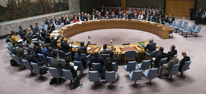 Members of the United Nations Security Council vote on a resolution demanding a 30-day humanitarian cease-fire across Syria, Saturday, Feb. 24, 2018 at United Nations headquarters.