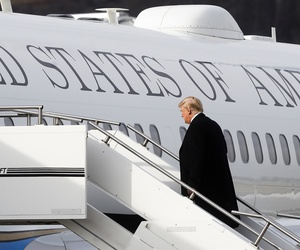 President Donald Trump boards Air Force One before leaving Cincinnati Municipal Lunken Airport, Feb. 5, 2018, in Cincinnati.