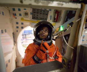 NASA astronaut Stephanie Wilson is attired in a training version of her shuttle launch and entry suit in a 2009 training mission.