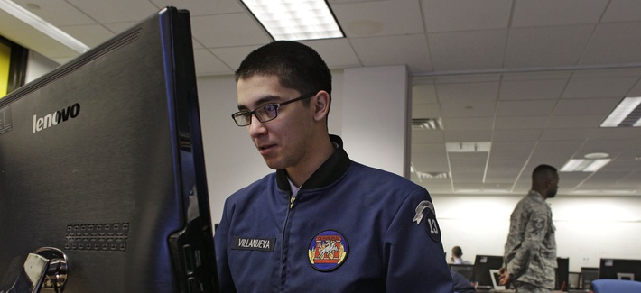 In this Feb. 20, 2013 photo, a cadet works at a large computer display inside a classroom at the Center for Cyberspace Research, where cyber warfare is taught, at the U.S. Air Force Academy, in Colorado Springs, Colo.