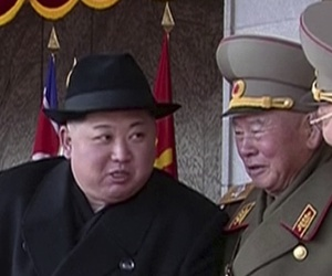 In this image made from video by North Korea's KRT, North Korean leader Kim Jong Un, center, speaks with military officials during a military parade in Pyongyang, North Korea Thursday, Feb. 8, 2018.