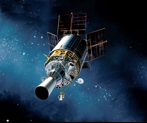 Air Force Space Command-operated Defense Support Program (DSP) satellite is illustrated in orbit.  In their 22,300-mile, geosynchronous orbits, DSP satellites help protect the U.S. and allies by detecting missile launches and nuclear detonations.