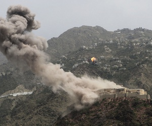 Smoke rises from al-Qahira castle, an ancient fortress near the Saber mountain, in the background, after Saudi-led air strikes in Taiz city, Yemen, May 2015.