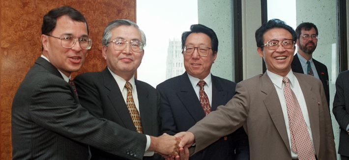 Officials from the U.S., South Korea, China, and North Korea shake hands on Aug. 5, 1997, in New York before the start of preparatory talks.