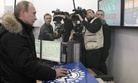 Vladimir Putin clicks on a computer mouse to fill a Russian tanker bound for Hong Kong at the terminal in the far eastern port of Kozmino, on Monday, Dec. 28, 2009