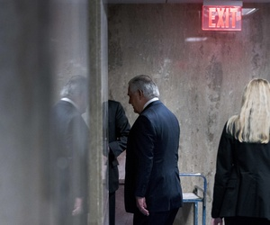 Secretary of State Rex Tillerson walks down a hallway after speaking at a news conference at the State Department in Washington, Tuesday, March 13, 2018.
