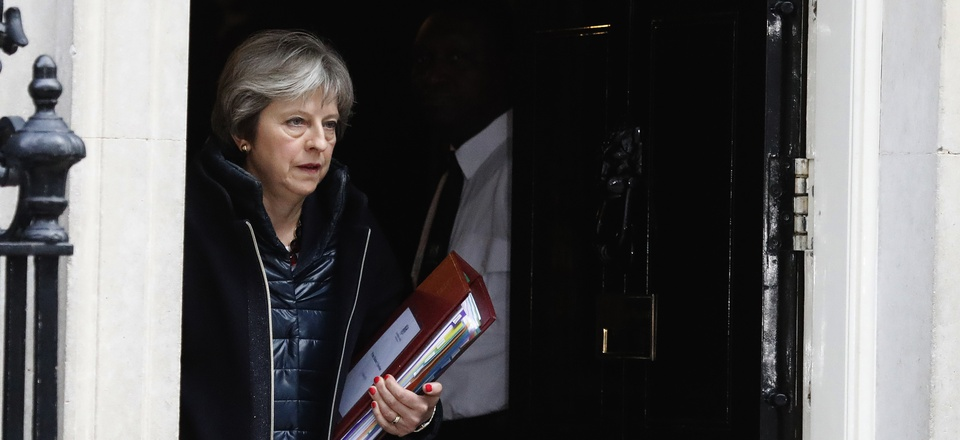 Britain's Prime Minister Theresa May leaves 10 Downing Street to attend the weekly Prime Ministers' Questions session, in parliament in London, March 14, 2018.