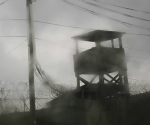 In this 2008 photo, a guard tower stands in the abandoned Camp X-Ray, the original and temporary detention facility on Guantanamo Bay U.S. Naval Base in Cuba.
