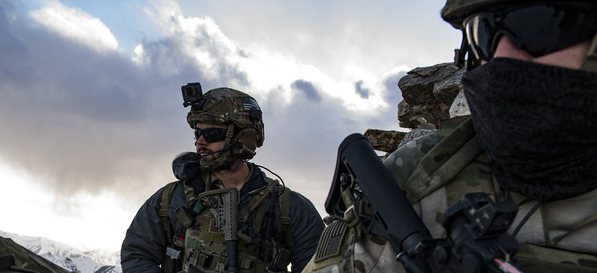 U.S. Air Force pararescuemen, assigned to the 83rd Expeditionary Rescue Squadron, survey the landscape during a training exercise at an undisclosed location in the mountains of Afghanistan, March 14, 2018.