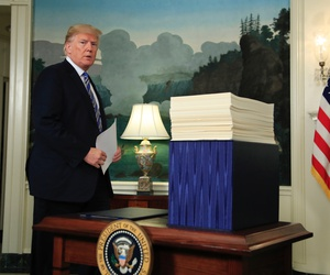 President Donald Trump arrives in the Diplomatic Room of the White House in Washington on March 23 to speak about the $1.3 trillion spending bill which he signed earlier in the day.