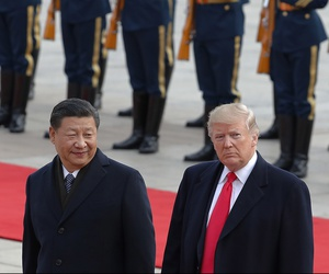 U.S. President Donald Trump, right, walks with Chinese President Xi Jinping during a welcome ceremony at the Great Hall of the people in Beijing, Thursday, Nov. 9, 2017.