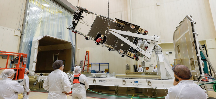 Lockheed plans to show the Saudi crown prince the Arabsat-6A satellite, here being prepared in a clean room near Denver before being moved to the company's Sunnyvale, California, facility for final testing.