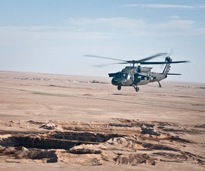 A U.S. UH-60 Black Hawk helicopter flies over the Syrian landscape on March 12.