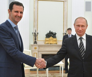 Russian President Vladimir Putin, right, shakes hand with Syria President Bashar Assad in the Kremlin in Moscow, Russia, Oct. 20, 2015.