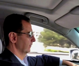 This frame grab from video released Sunday, March, 18, 2018 by the official Facebook page of the Syrian Presidency, shows Syrian President Bashar Assad driving himself to the newly captured areas of eastern Ghouta, near the capital Damascus, Syria.