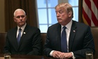 President Donald Trump, right, sitting next to Vice President Mike Pence, left, speaks in the Cabinet Room of the White House in Washington, April 9, 2018, at the start of a meeting with military leaders.