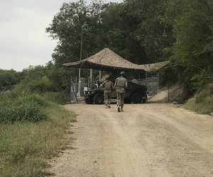 National Guard troops guard the border in Roma, Texas, on April 10, 2018.