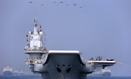 China's aircraft carrier Liaoning and other vessels and fighter jets in the maritime parade conducted by the Chinese People's Liberation Army (PLA) Navy in the South China Sea on the morning of April 12, 2018.