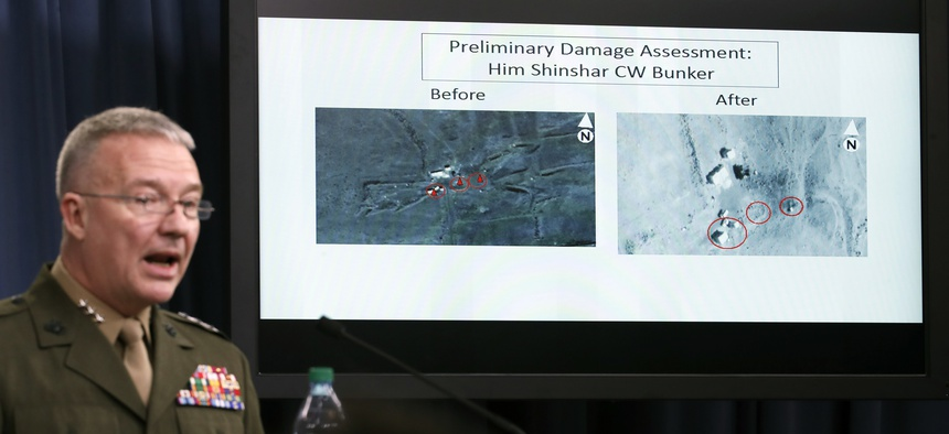 Marine Lt. Gen. Kenneth F. McKenzie Jr., director, Joint Staff, speaks as he shows photographs from before and after the U.S.-led airstrikes against Syria during a media availability at the Pentagon on April 14, 2018.