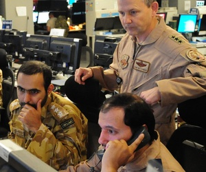 U.S. Air Forces Central Command commander Lt. Gen. John Hesterman III looks on as Gulf Cooperation Council liaison officers participate in an exercise at the Combined Air Operations Center, Nov. 26, 2014, at Al Udeid Air Base, Qatar.