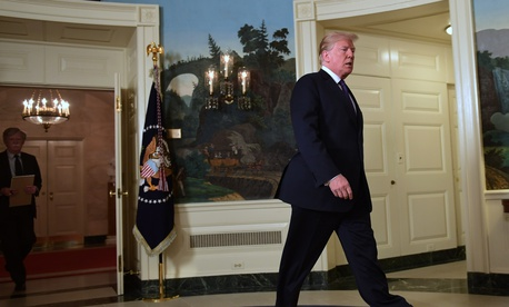 President Donald Trump walks into the Diplomatic Reception Room of the White House on Friday, April 13, 2018, in Washington, to speak about the United States' military response to Syria's chemical weapon attack on April 7.