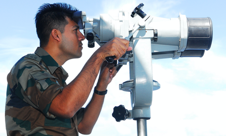 "An Indian army major looks through ""the big eyes"" on the bridge of the amphibious assault ship USS Essex during a joint exercise. The nominee to head PACOM said he'll devote ""great energy"" to the U.S.-India relationship."