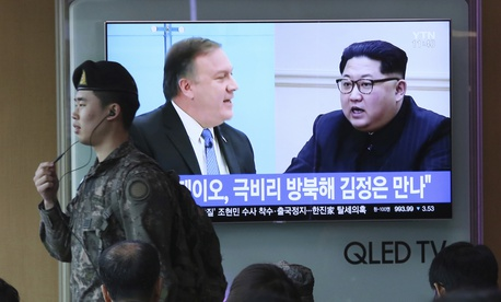 Mike Pompeo, left, and North Korean leader Kim Jong Un during a news program at the Seoul Railway Station in Seoul, South Korea on April 18, 2018.