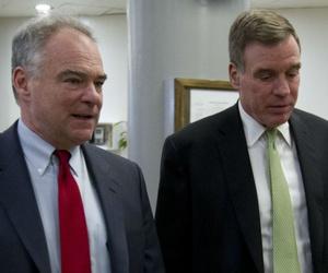 Virginia Democratic Sens. Tim Kaine (left) and Mark Warner walk to the Senate floor earlier this year.