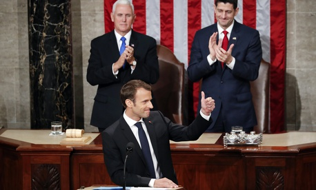 French President Emmanuel Macron spoke to a joint meeting of Congress in Washington, Wed., April 25, 2018. Behind him is Vice Pres. Mike Pence and House Speaker Paul Ryan, R-Wisc.