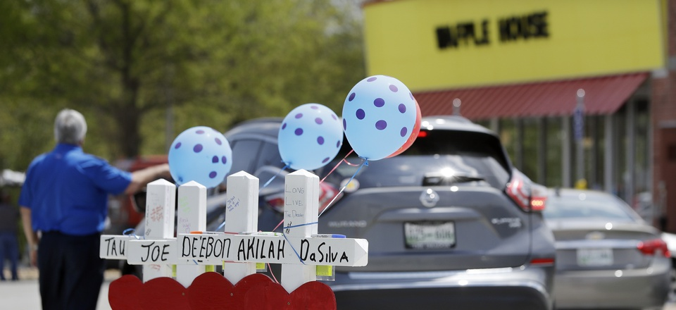 Four wooden crosses stand as a memorial for the four shooting fatalities outside a Waffle House restaurant Wednesday, April 25, 2018, in Nashville, Tenn.