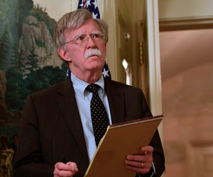 National Security Adviser John Bolton attends a meeting with President Trump in the White House, in April.