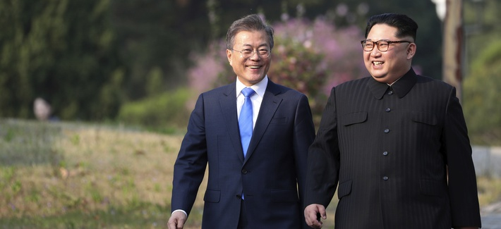 North Korean leader Kim Jong Un, right, and South Korean President Moon Jae-in walk together at the border village of Panmunjom in the Demilitarized Zone, South Korea, Friday, April 27, 2018.