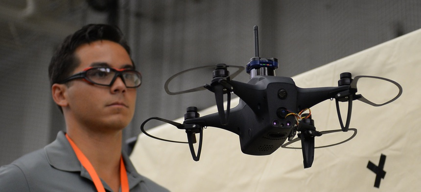 Brandon Tseng commands an autonomous drone during the ThunderDrone Tech Expo at SOFWERX in Tampa, Fla., in September.