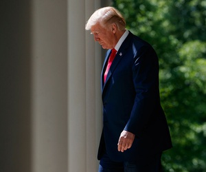 "President Donald Trump arrives for a ""National Day of Prayer"" event in the Rose Garden of the White House Thursday."