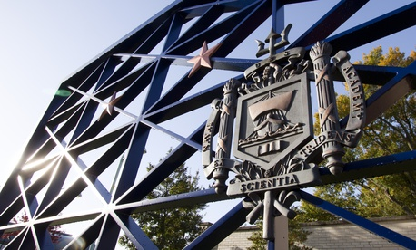 The USNA coat-of-arms on the entrance gates to the US Naval Academy in downtown Annapolis on October 21, 2012 in Annapolis, Maryland.