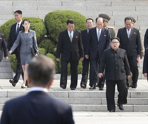 North Korean leader Kim Jong Un, center, walks toward South Korean President Moon Jae-in at the border village of Panmunjom in the Demilitarized Zone, South Korea, Friday, April 27, 2018.