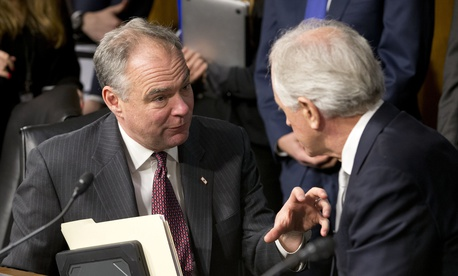 Senate Foreign Relations Committee Chairman Sen. Bob Corker, R-Tenn., right, confers with committee member Sen. Tim Kaine, D-Va. on Capitol Hill in Washington, Wednesday, Jan. 11, 2017