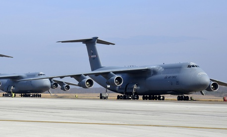 Three U.S. Air Force C-5 Galaxy cargo aircraft sit lined up on the flightline at Westover Air Reserve Base, Mass.